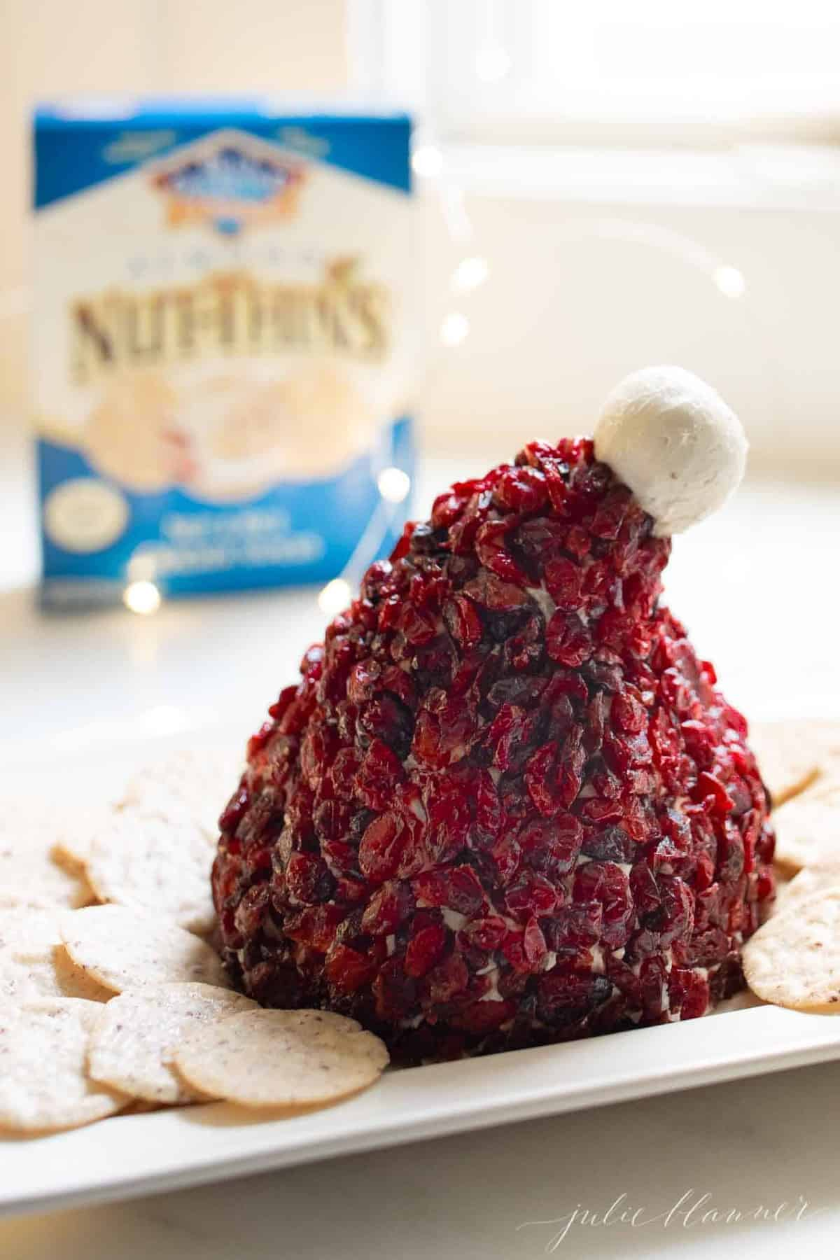 santa hat cranberry cheese ball on platter