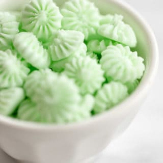 A bowl of green candies