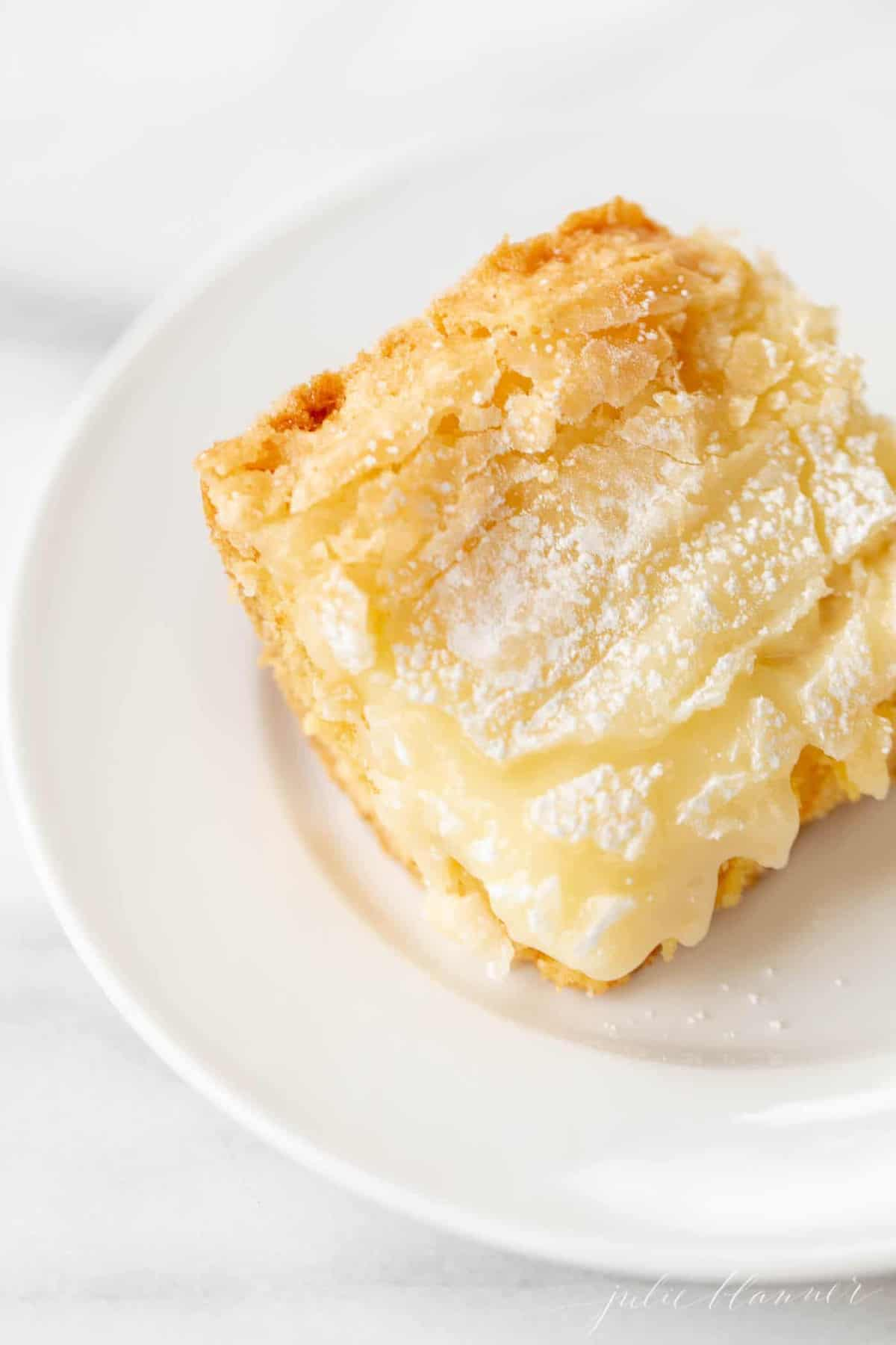 slice of gooey butter cake on a white plate