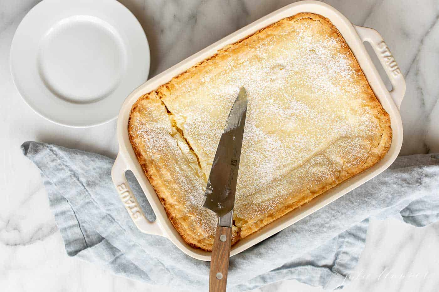 gooey butter cake sliced in a baking dish