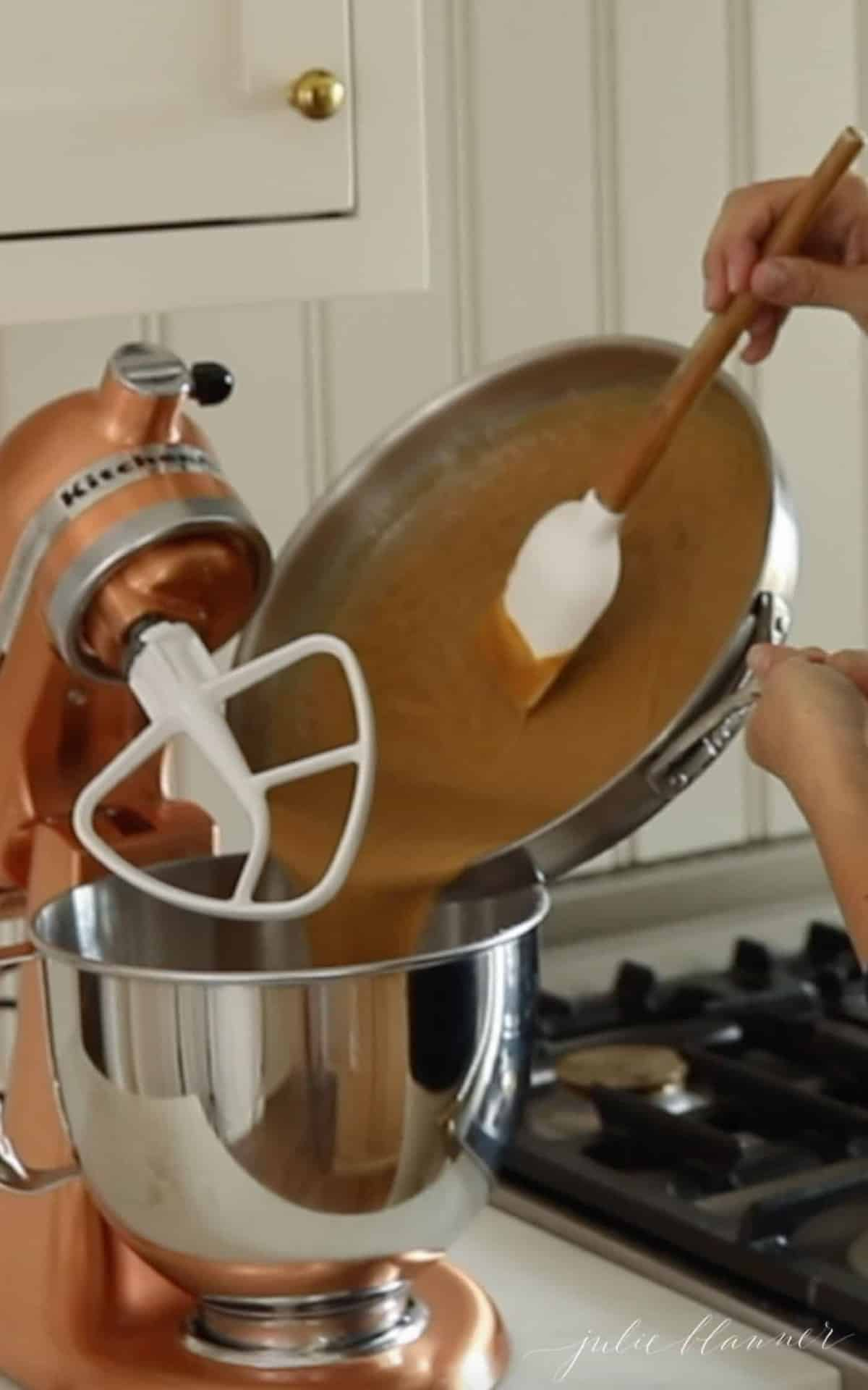 pouring peanut butter mixture into mixing bowl