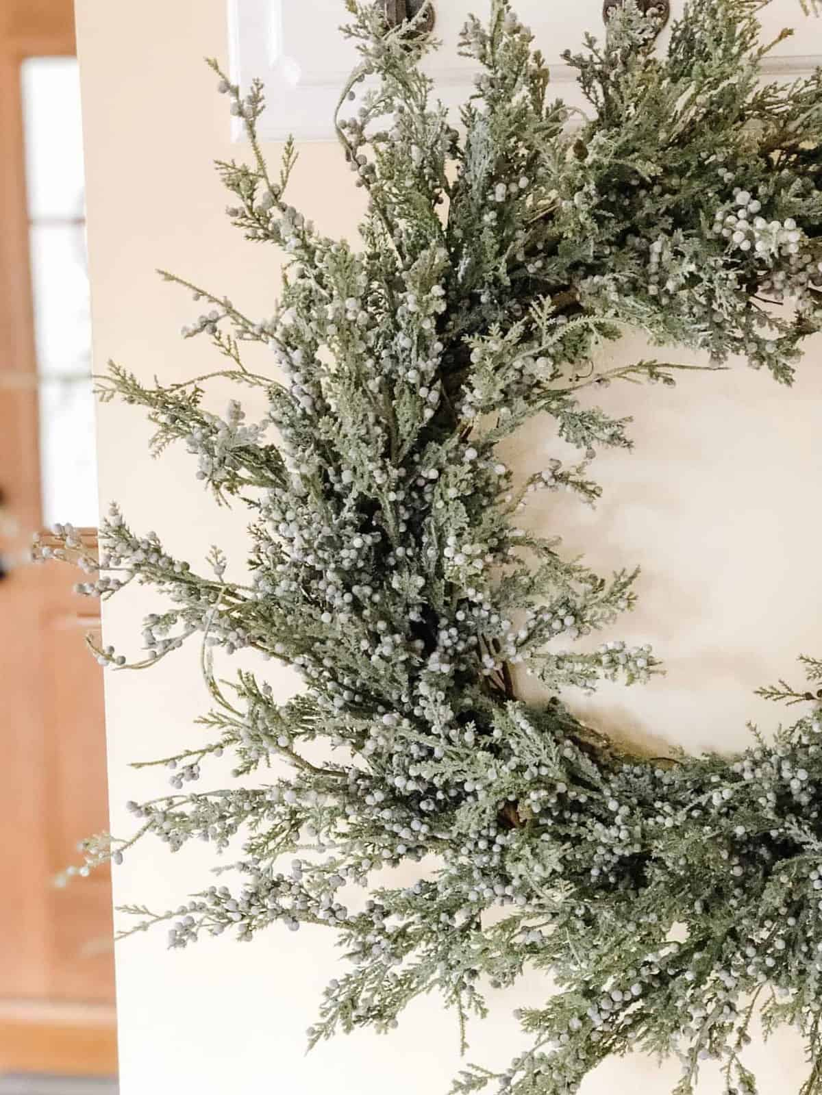 Close up of a blue juniper berry wreath for Christmas.