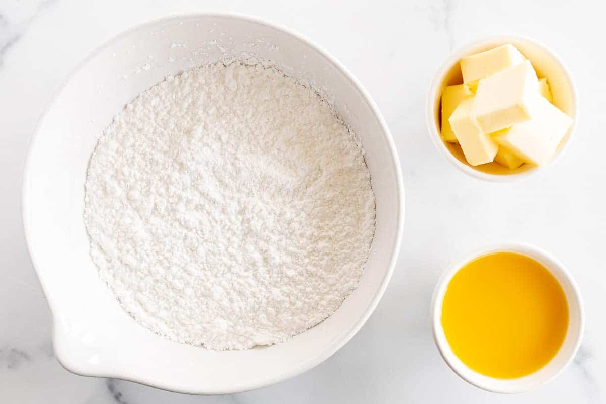 powdered sugar butter and orange juice in bowls