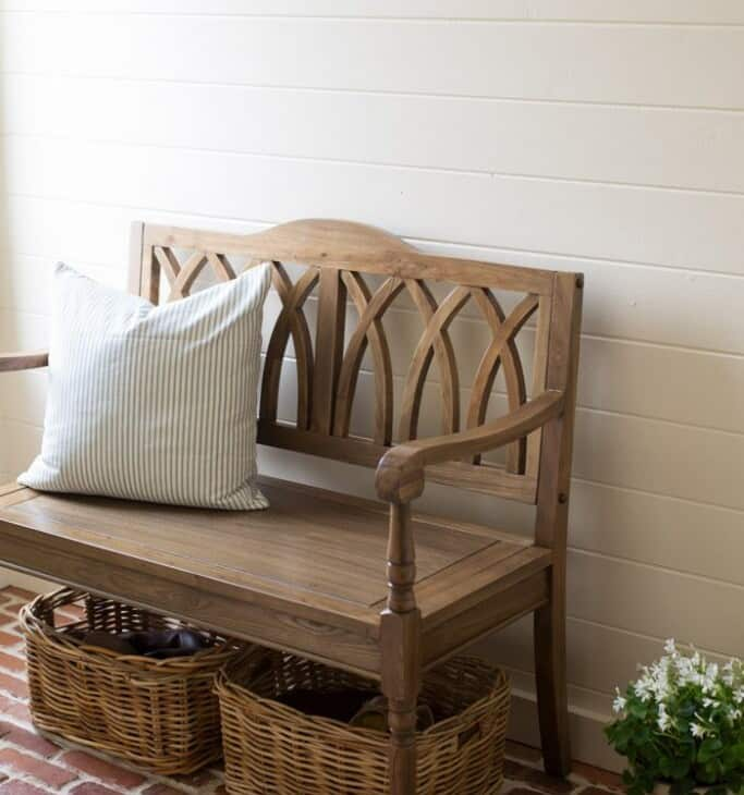 An entrance bench with storage baskets underneath.