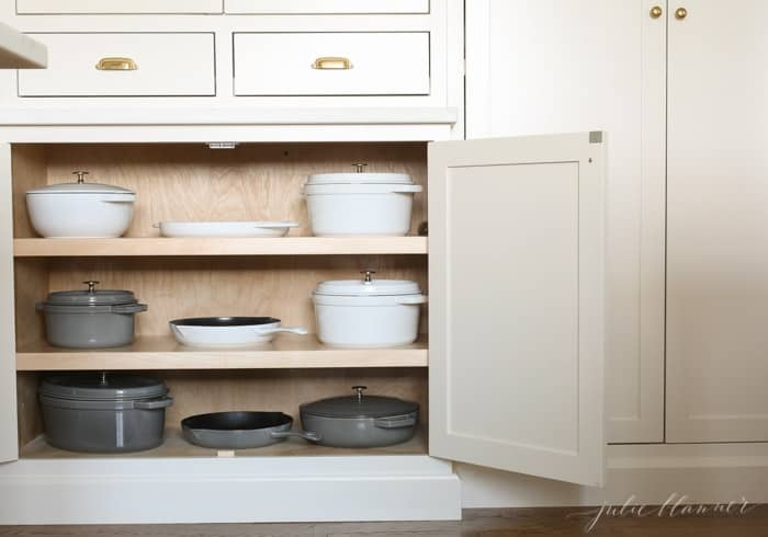 Storage for pots and pans in a minimalist kitchen.