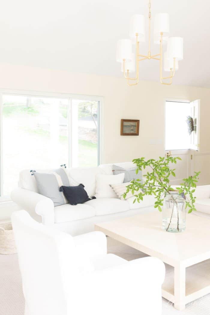 Simple living in a white living room filled with sunlight.