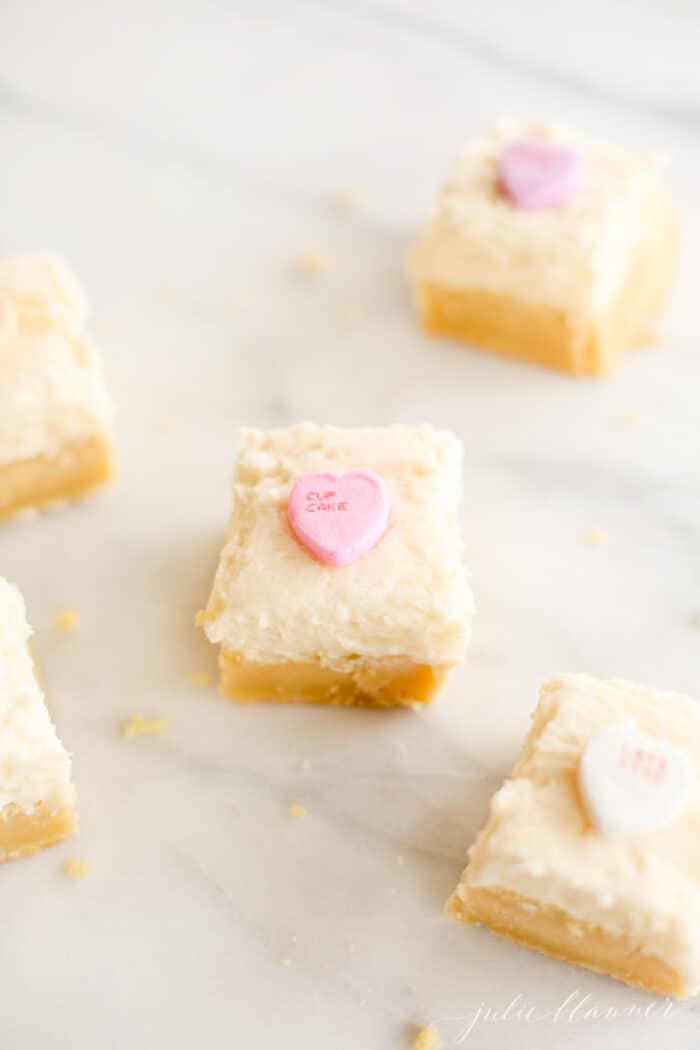 frosted sugar cookie bars on marble surface