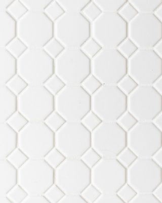 White hexagon tile floor, white grout.