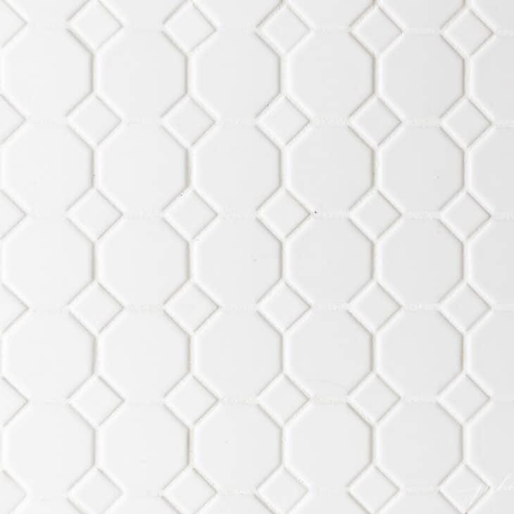 White hexagon tile floor, white grout.