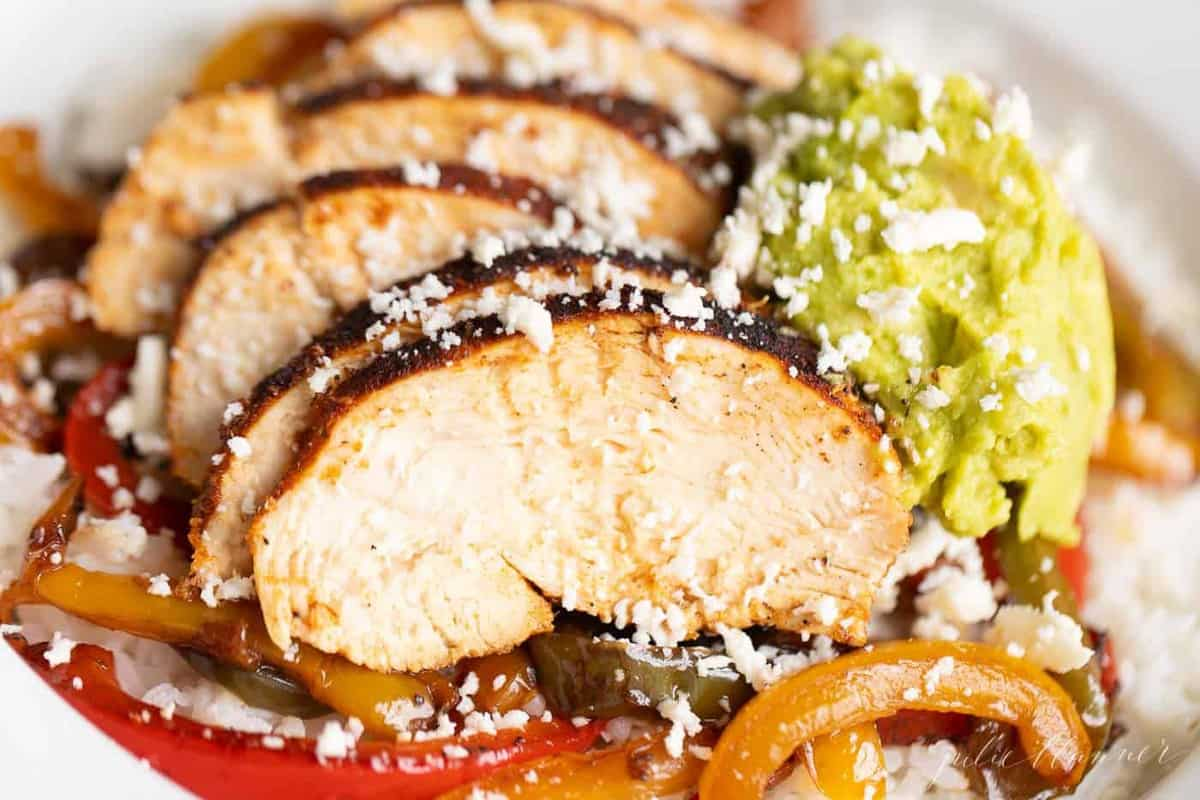 closeup of chicken over rice with fajita peppers