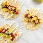 3 open faced chorizo tacos on marble
