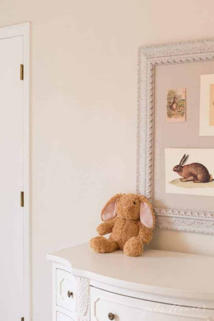 A child's bedroom with a pin board featuring Easter images for minimalist seasonal decor.