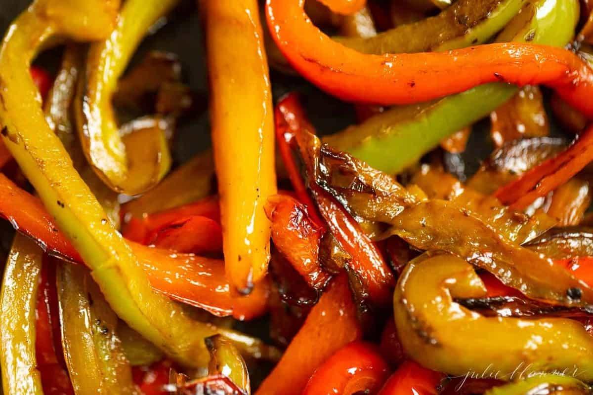 A close up shot of colorful sauteed fajita peppers.