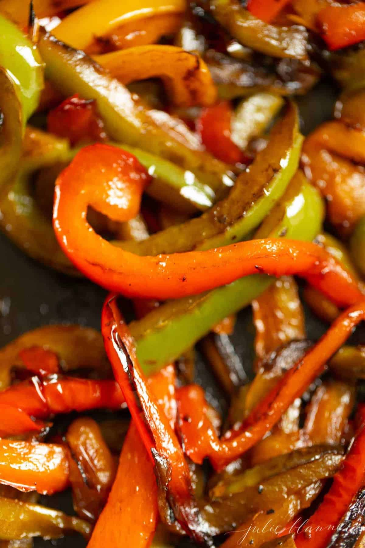Close up shot of slice and sauteed bell peppers.
