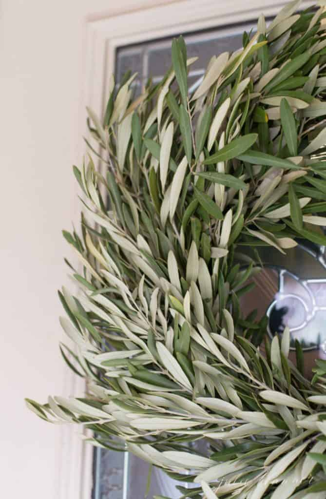 Close up of a fresh olive wreath used for minimalist seasonal decorating.
