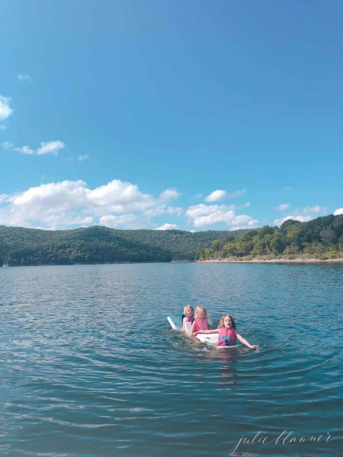 3 girls swimming in table rock lake