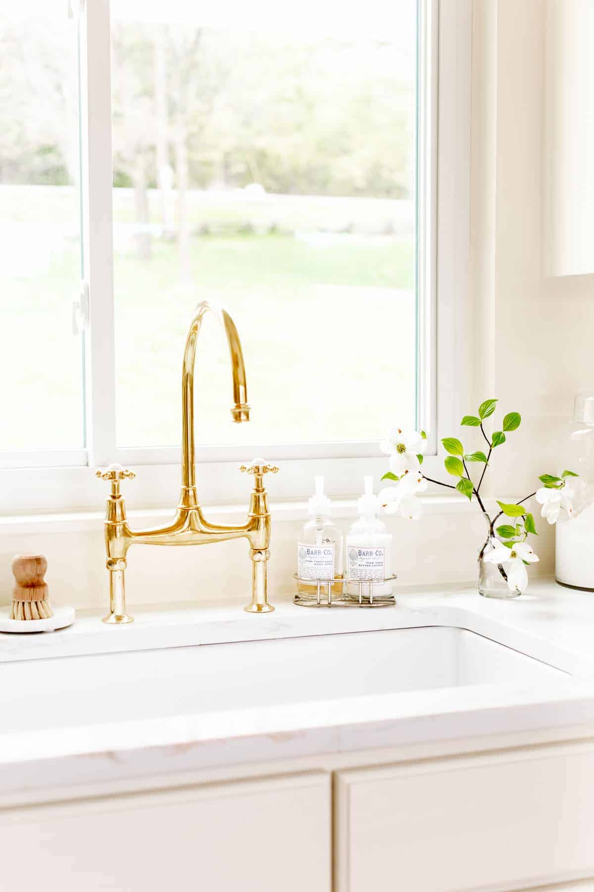 unlacquered brass faucet in kitchen