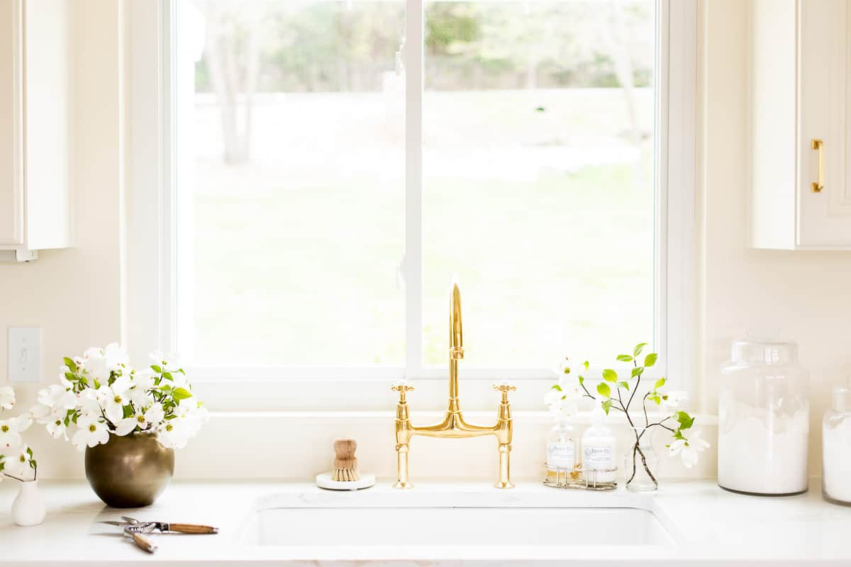unlacquered brass faucet and kitchen sink