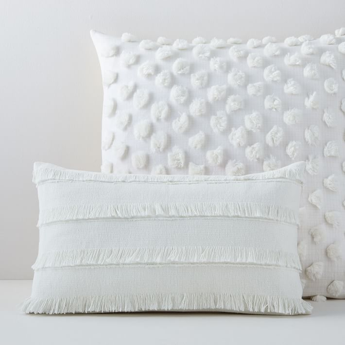 White product shot of two textured white pillow covers.