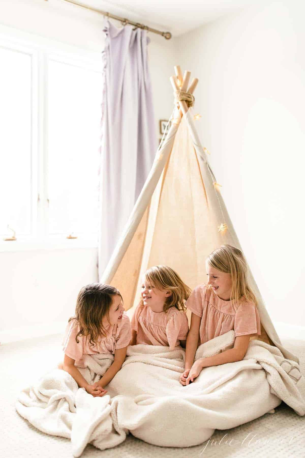 kids in teepee