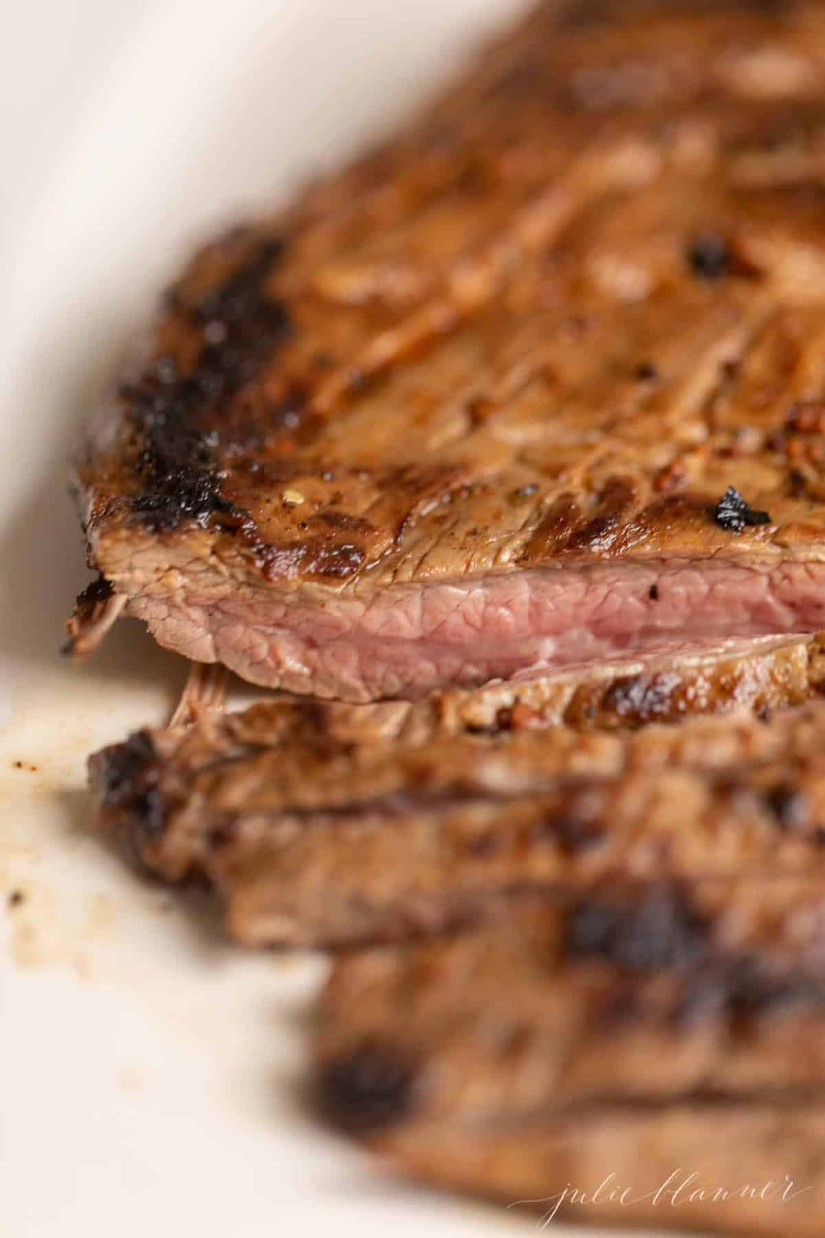 A close up of sliced carne asada steak