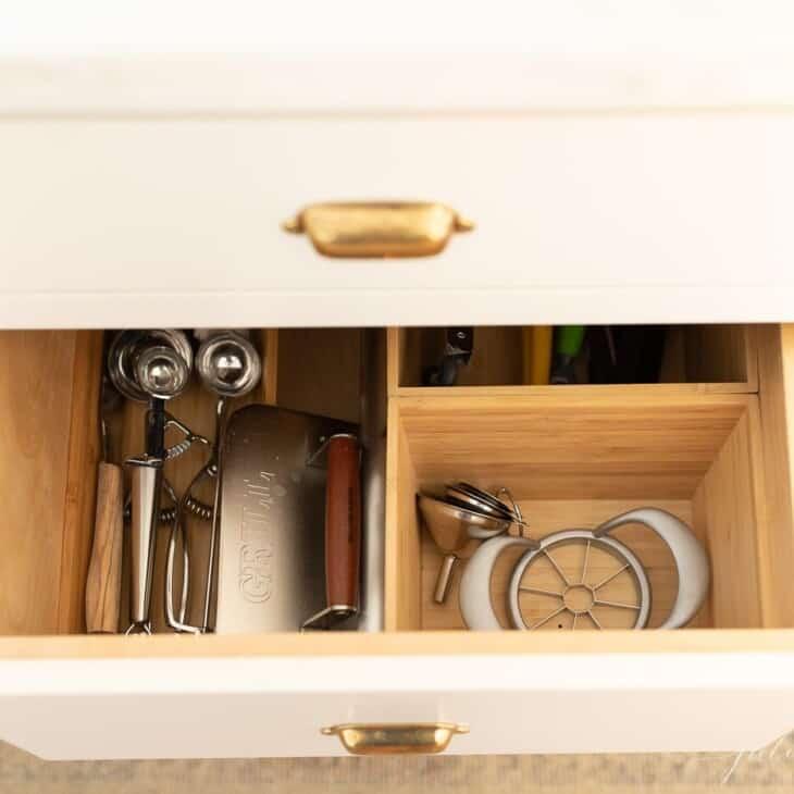 Looking into a silverware drawer organizer full of kitchen utensils.