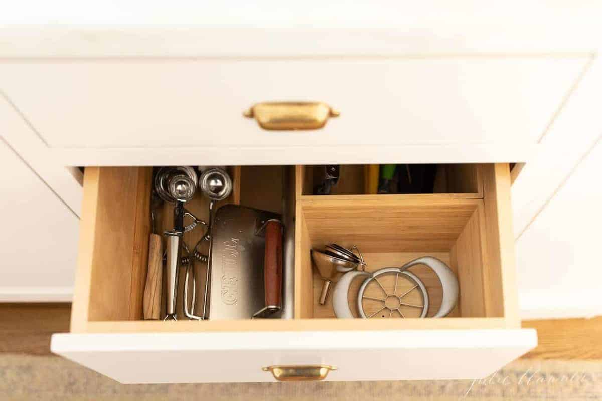 Looking into a silverware drawer organizer full of kitchen utensils.