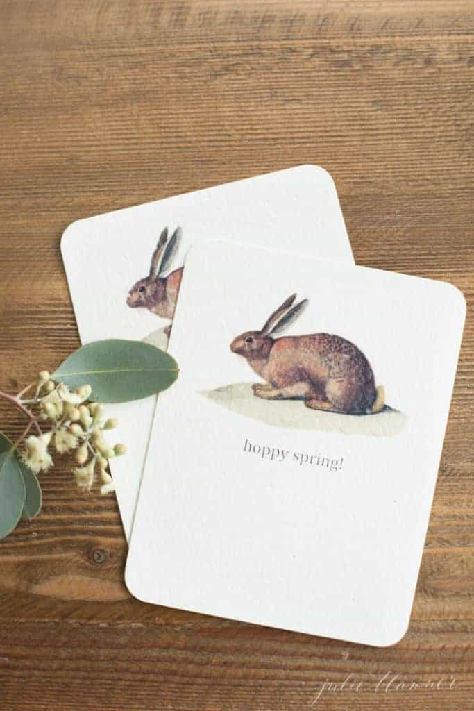 A wooden surface with sweet printable Easter decorating card ideas.