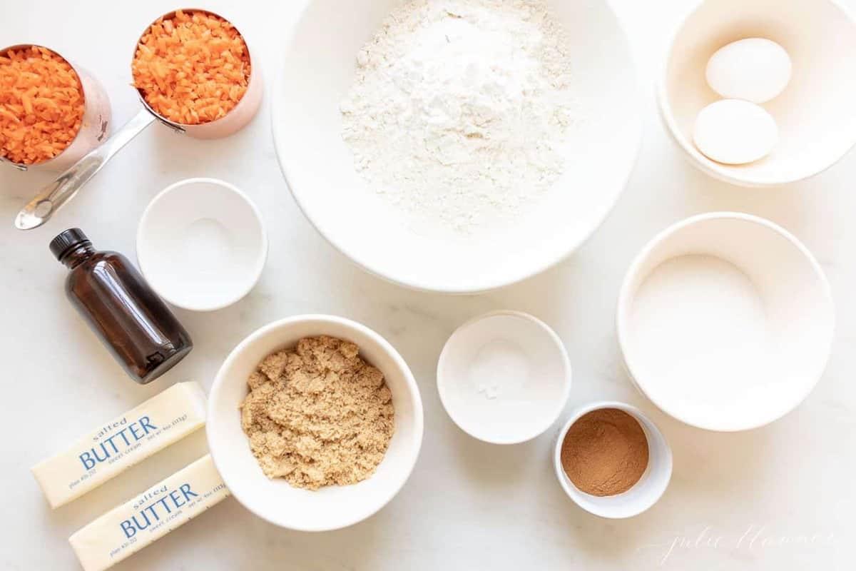 Ingredients for baking in white ramekins.
