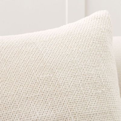 closeup up ivory textured pillow