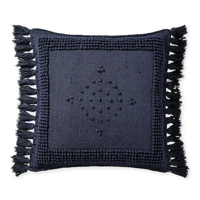 navy outdoor pillow with tassels
