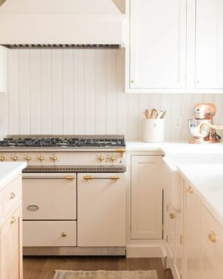 A cream cabinet with an apron front sink.