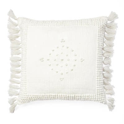 white outdoor pillow with tassels