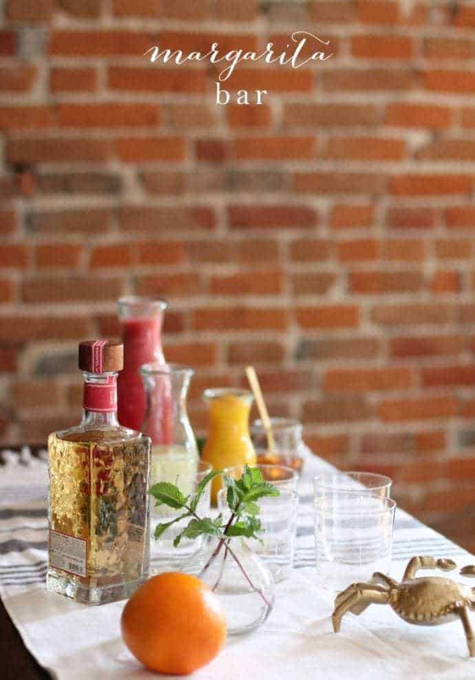 brick background with a margarita bar with the best tequila for margaritas.