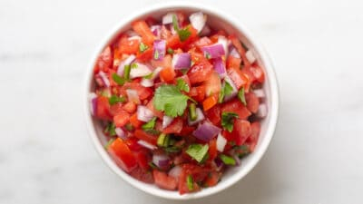 Looking into a bowl full of an easy chopped pico de gallo recipe