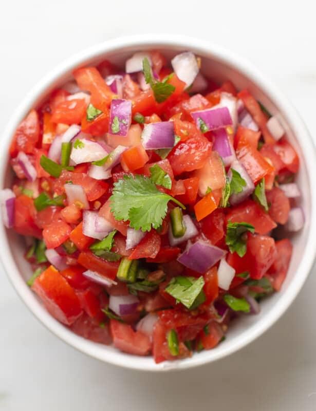 Looking into a bowl full of an easy chopped pico de gallo recipe
