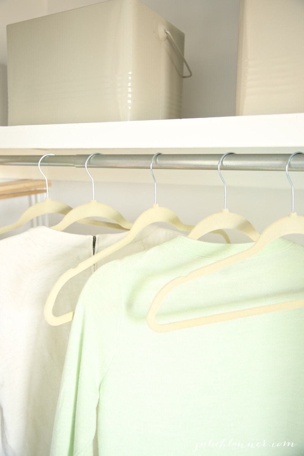 A closet with bins for cleaning supplies and more organization ideas.