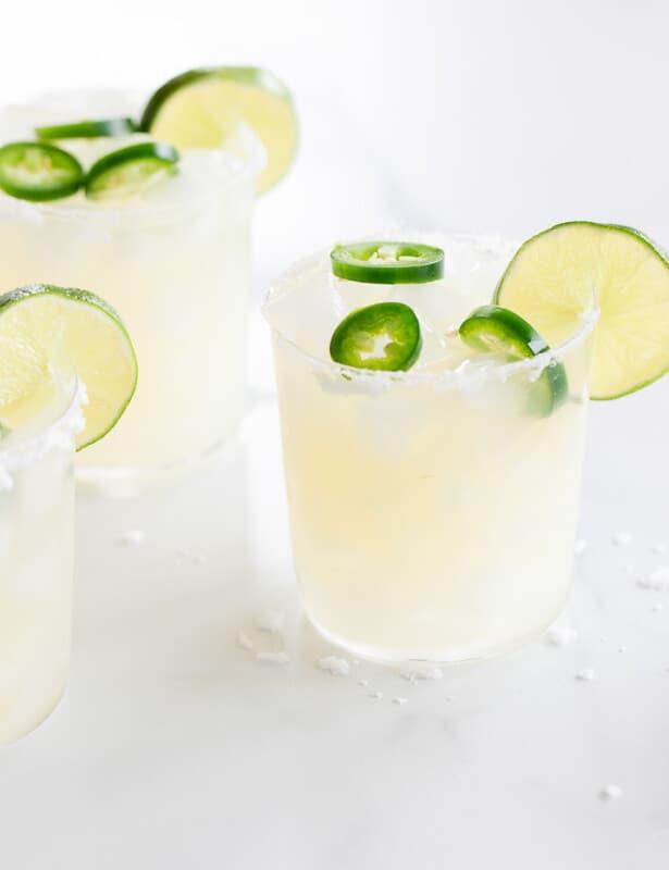 Marble surface, three glasses full of jalapeno margaritas.