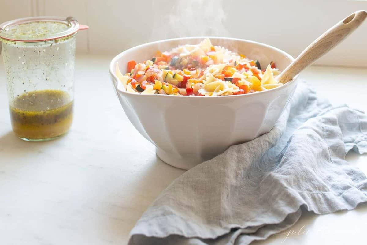 A steaming pot of veggie pasta salad.