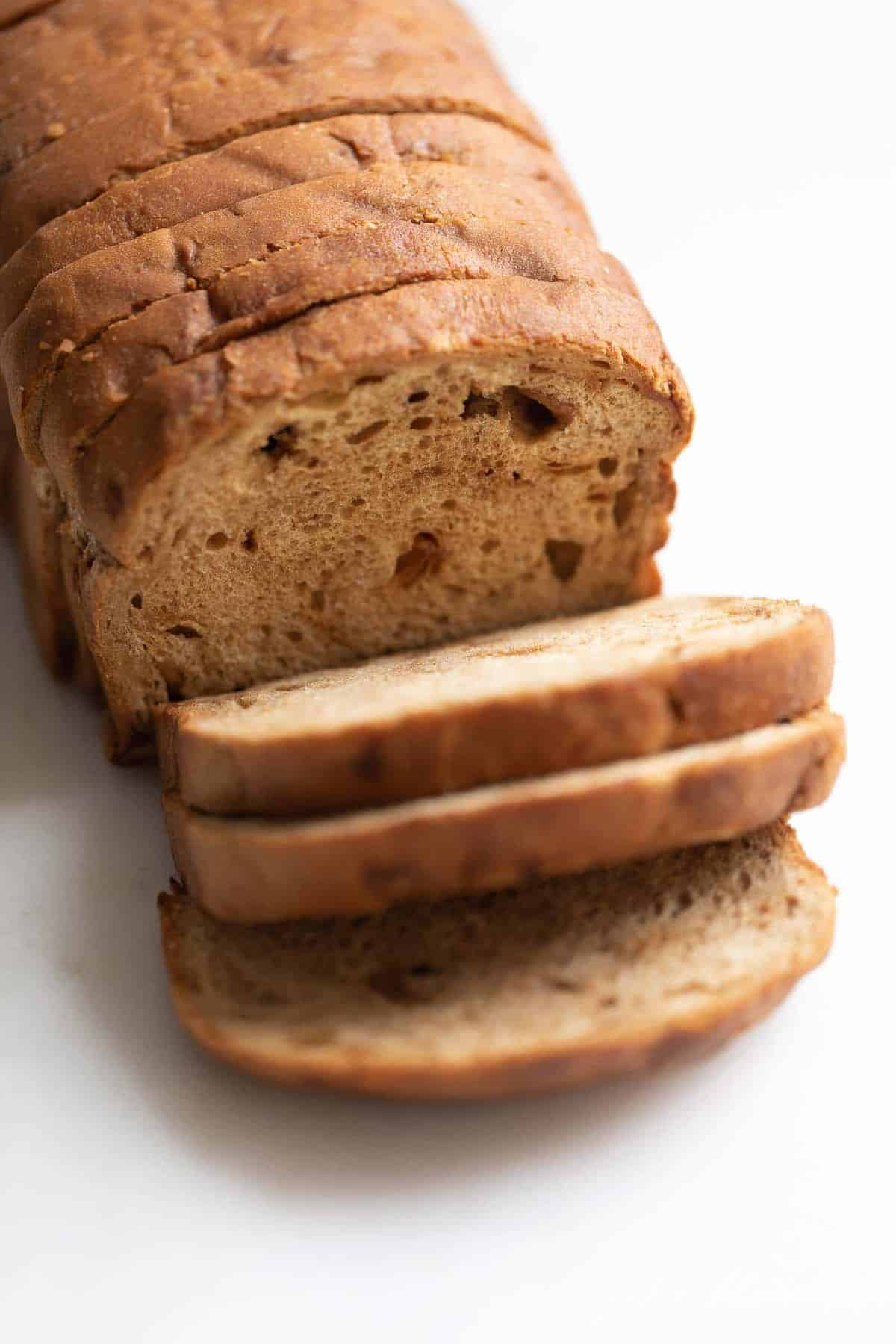 A loaf of apple fritter bread, sliced.
