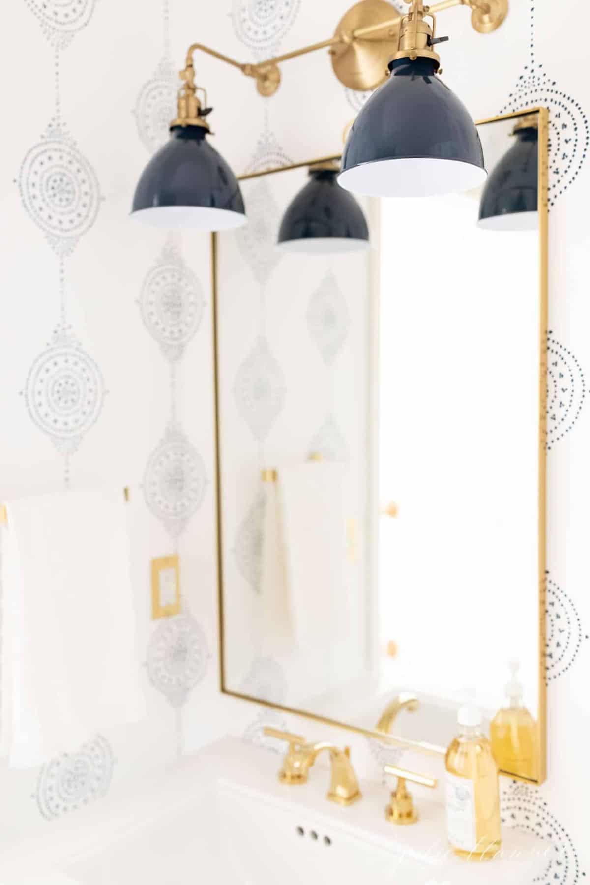 A brass mirror in a modern bathroom refresh.