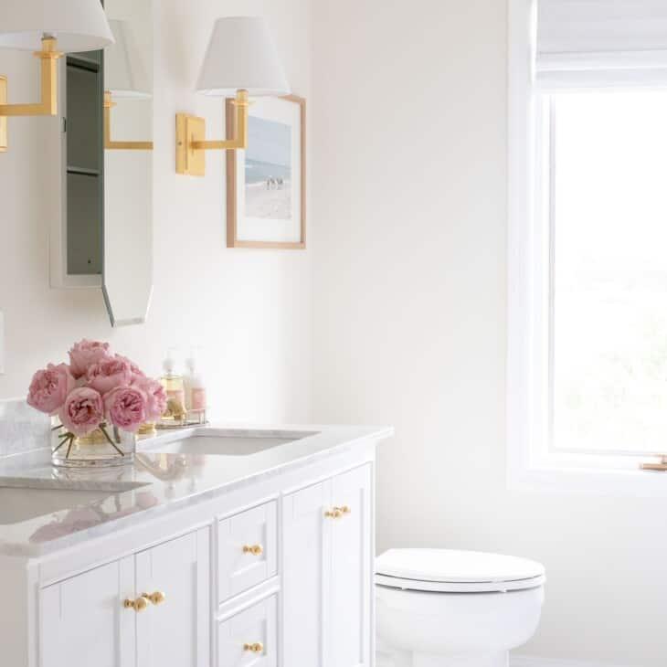 A pretty white bathroom with Benjamin Moore White Dove trim paint.
