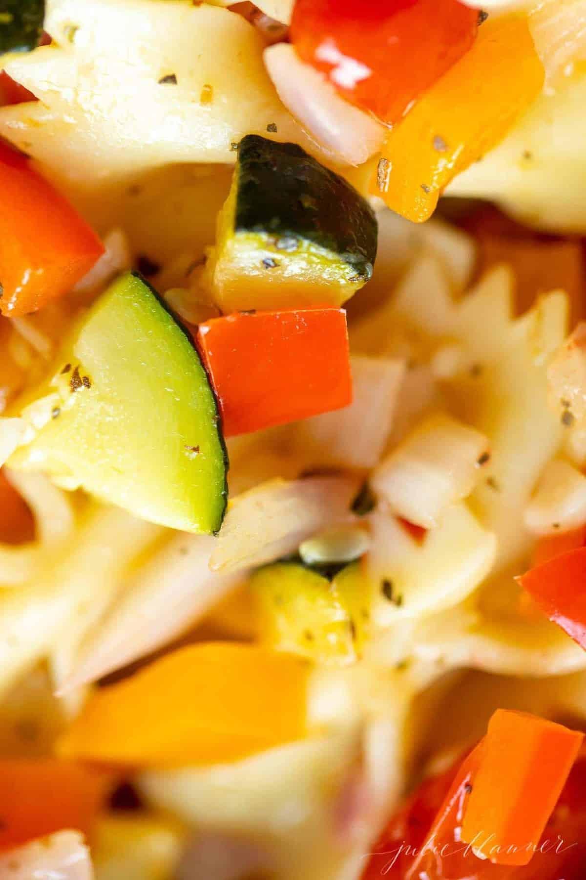 A close up shot of veggie pasta salad.