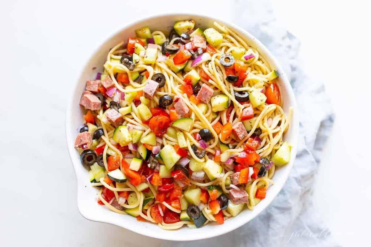 A white bowl full of homemade Italian spaghetti salad.