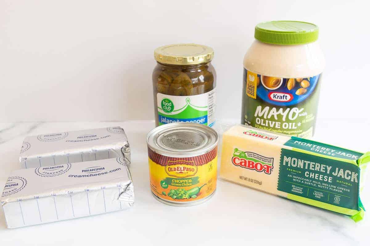 ingredients to make jalapeño dip on white surface