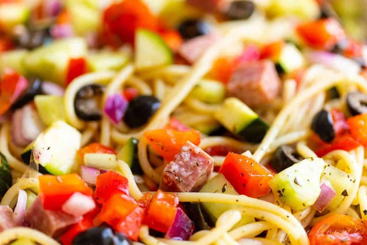 Close up of the veggies in a bowl of spaghetti salad
