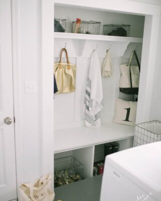 Farmhouse style mudroom with hooks and baskets, closet mudroom space.