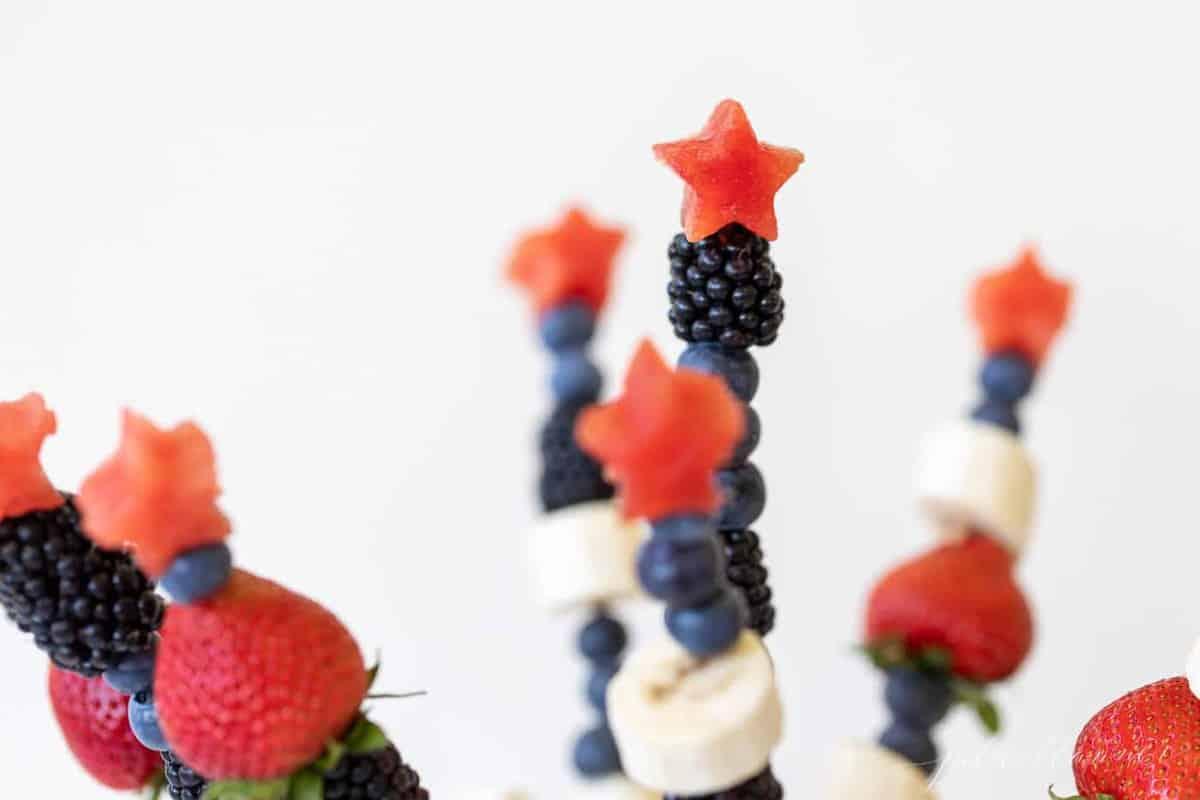 Close up of fourth of july inspired fresh fruit kabobs made of summer berries.