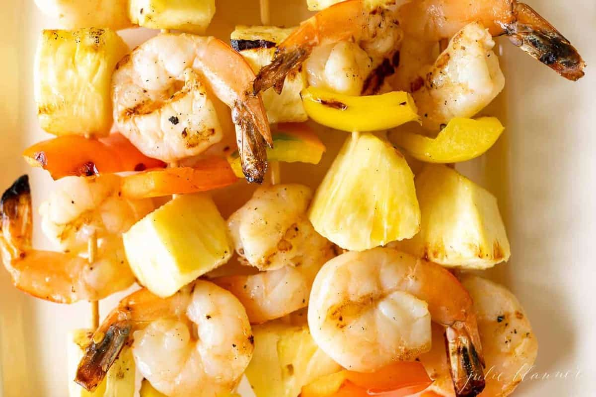 Close up shot of pineapple shrimp recipe on bamboo skewers.
