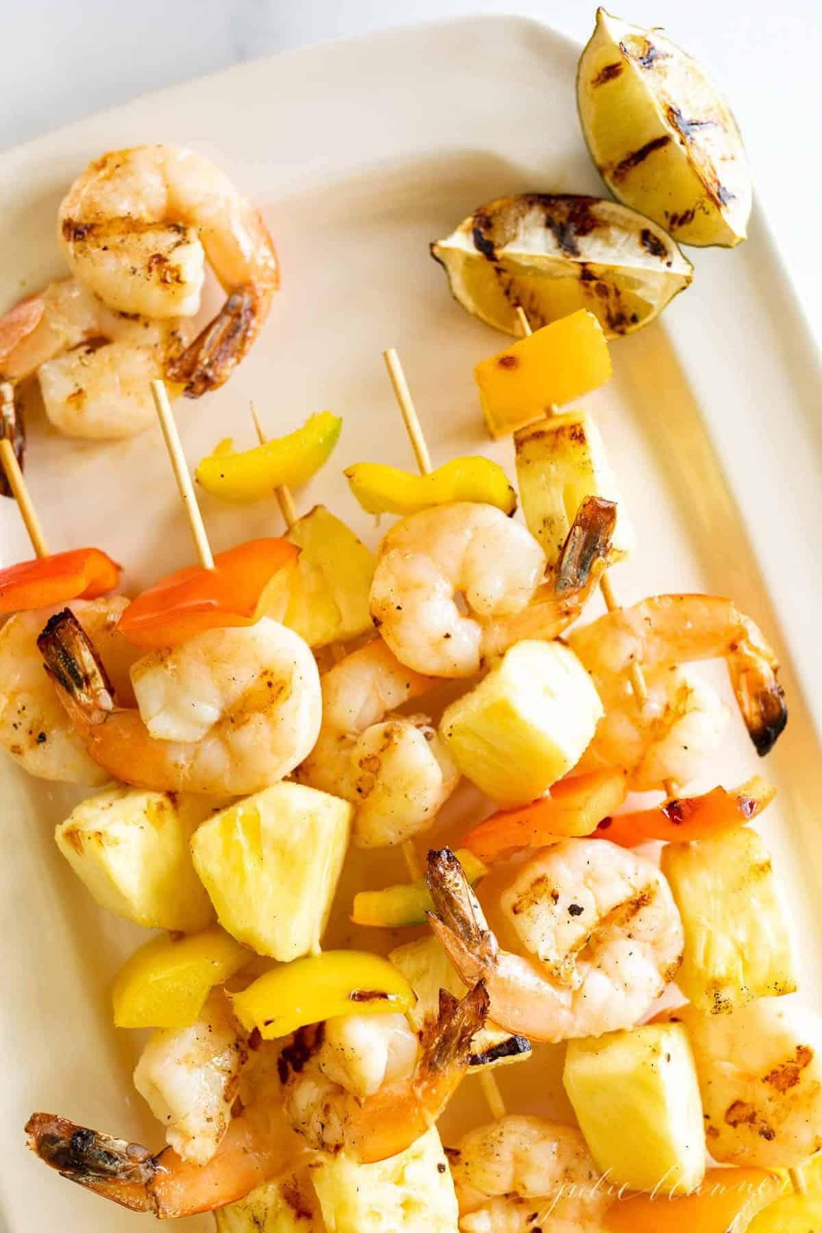 Grilled pineapple shrimp recipe on bamboo skewers.
